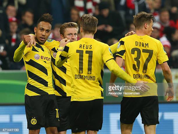 PierreEmerick Aubameyang of Dortmund celebrates scoring his teams goal with teamates during the DFB Cup semi final match between FC Bayern Muenchen...
