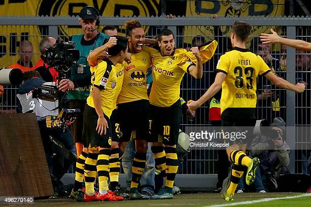 PierreEmerick Aubameyang of Dortmund celebrates the third goal with Shinji Kagawa Henrikh Mkhitaryan and Julian Weigl of Dortmund during the...