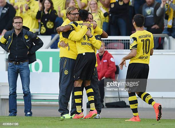 PierreEmerick Aubameyang of Dortmund celebrates with his teammate and head coach Juergen Klopp of Dortmund after scoring his team's secon goal during...