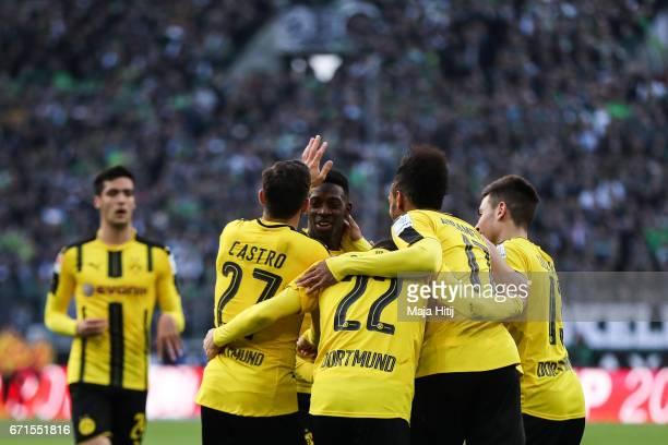PierreEmerick Aubameyang of Dortmund celebrates with his teammates after scoring a goal to make it 22 during the Bundesliga match between Borussia...