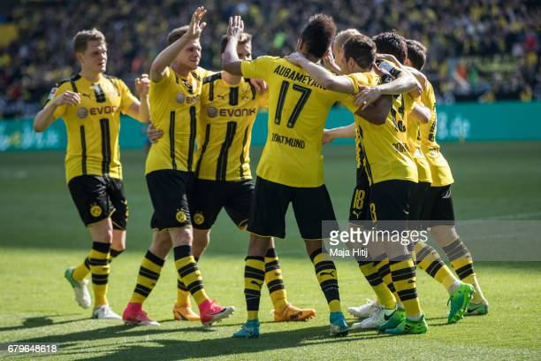PierreEmerick Aubameyang of Dortmund celebrates with his teammates after scoring his team's goal to make it 20 during the Bundesliga match between...