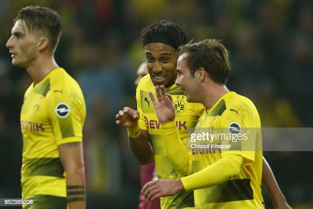 PierreEmerick Aubameyang of Dortmund celebrates with Mario Goetze of Dortmund and Maximilian Philipp of Dortmund after he scored his teams third goal...