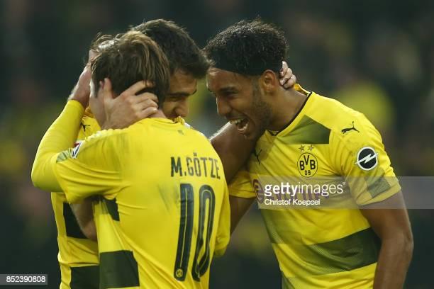 PierreEmerick Aubameyang of Dortmund celebrates with Mario Goetze of Dortmund and Sokratis Papastathopoulos of Dortmund after he scored his teams...