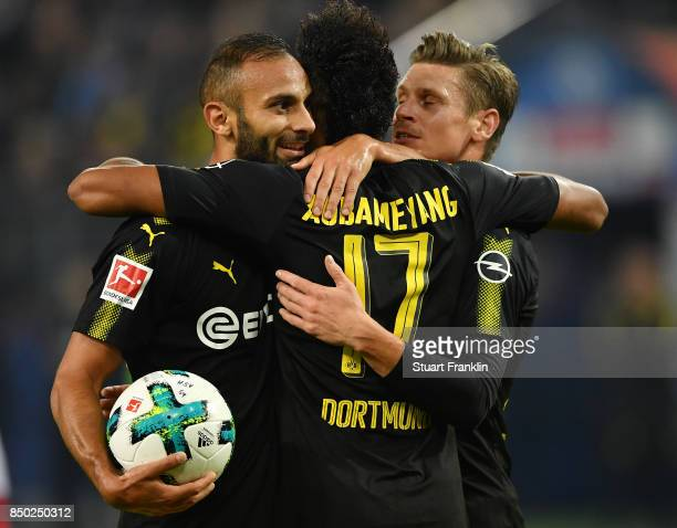 PierreEmerick Aubameyang of Dortmund celebrates with Oemer Toprak of Dortmund and Lukasz Piszczek of Dortmund after he scores his teams second goal...