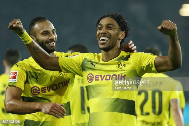 PierreEmerick Aubameyang of Dortmund celebrates with Oemer Toprak of Dortmund after he scored his teams fifth goal to make it 50 during the...