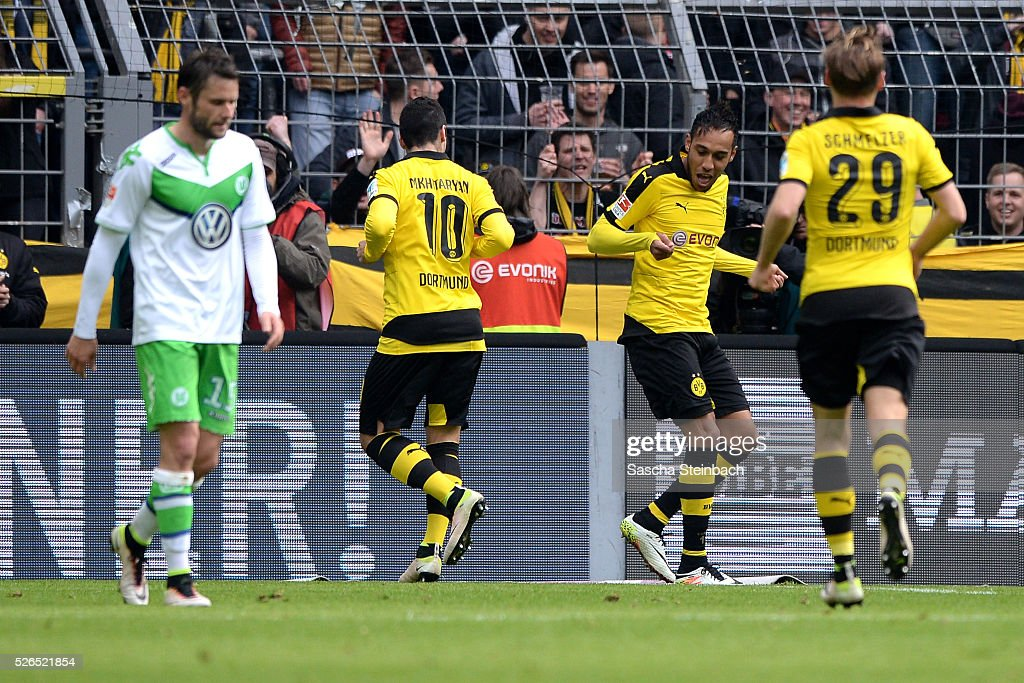 Pierre-Emerick Aubameyang (2-R) of Dortmund celebrates with team mate Henrikh Mkhitaryan (2-L) after scoring his team's fifth goal during the Bundesliga match between Borussia Dortmund and VfL Wolfsburg at Signal Iduna Park on April 29, 2016 in Dortmund, Germany.