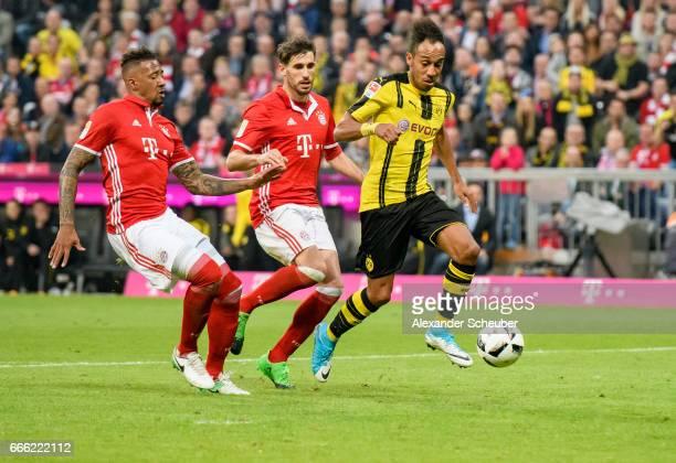 PierreEmerick Aubameyang of Dortmund challenges Jerome Boateng of Bayern Muenchen during the Bundesliga match between Bayern Muenchen and Borussia...