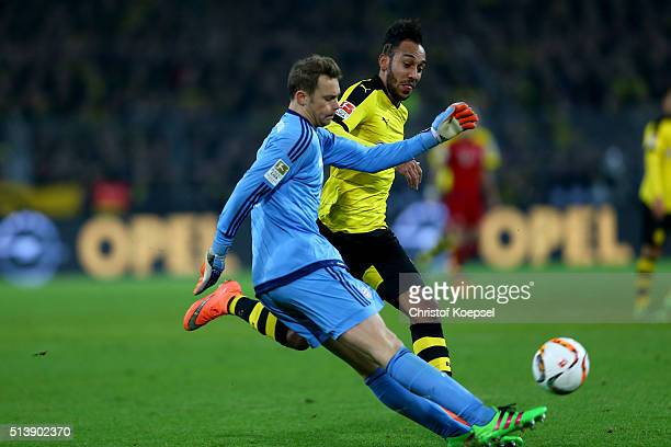 PierreEmerick Aubameyang of Dortmund challenges Manuel Neuer of Bayern during the Bundesliga match between Borussia Dortmund and FC Bayern Muenchen...