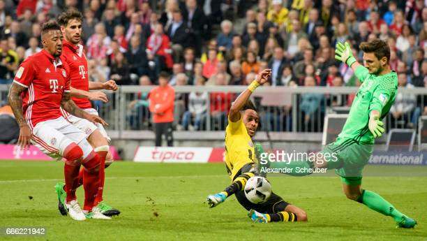 PierreEmerick Aubameyang of Dortmund challenges Sven Ulreich of Bayern Muenchen during the Bundesliga match between Bayern Muenchen and Borussia...