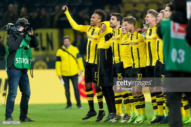 PierreEmerick Aubameyang of Dortmund Emre Mor of Dortmund and Sokratis of Dortmund celebrate their win during the Bundesliga match between Borussia...