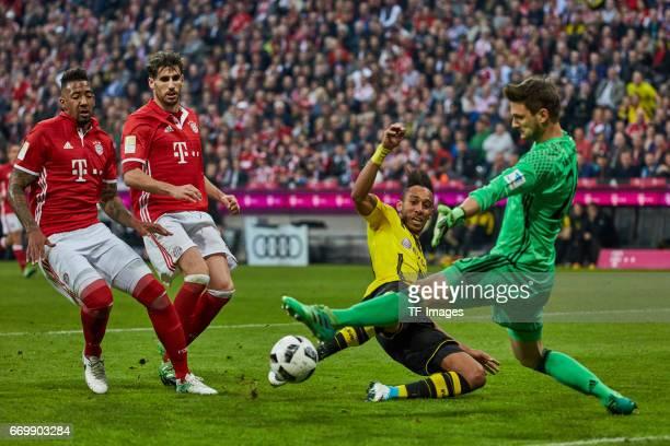 PierreEmerick Aubameyang of Dortmund Goalkeeper Sven Ulreich of Munich and Jerome Boateng of Munich battle for the ball during the Bundesliga match...