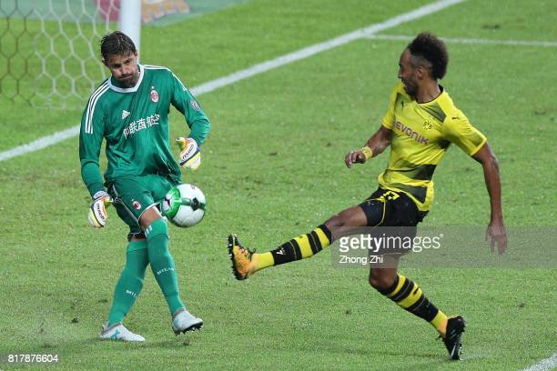 PierreEmerick Aubameyang of Dortmund in action against Marco Storari of AC Milan during the 2017 International Champions Cup football match between...