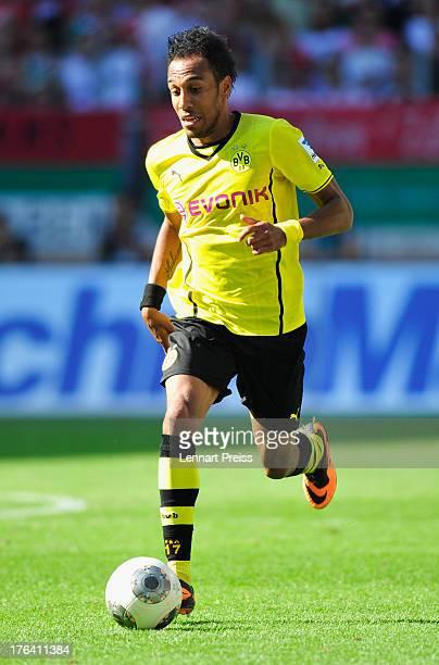 PierreEmerick Aubameyang of Dortmund in action during the Bundesliga match between FC Augsburg and Borussia Dortmund at SGL Arena on August 10 2013...