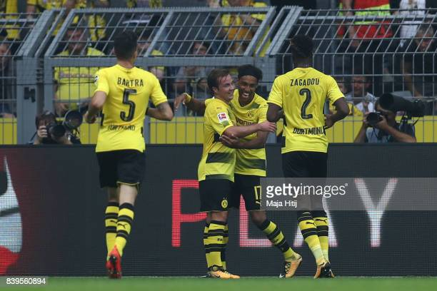 PierreEmerick Aubameyang of Dortmund is celebrated by Mario Goetze of Dortmund and his team mates after he scored to make it 10 during the Bundesliga...