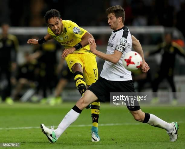 PierreEmerick Aubameyang of Dortmund is challenged by David Abraham of Frankfurt during the DFB Cup final match between Eintracht Frankfurt and...