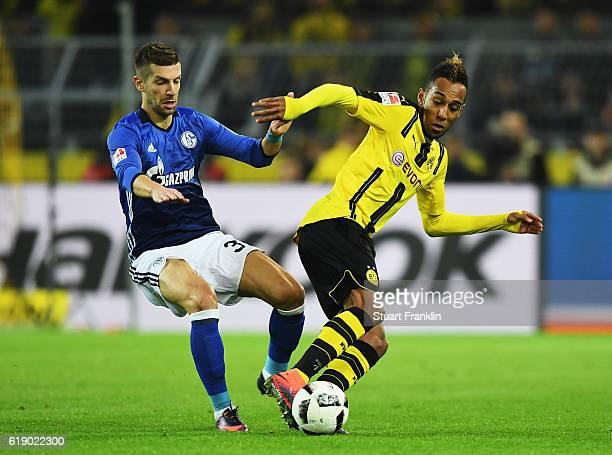 PierreEmerick Aubameyang of Dortmund is challenged by Matija Nastasic of Schalke during the Bundesliga match between Borussia Dortmund and FC Schalke...
