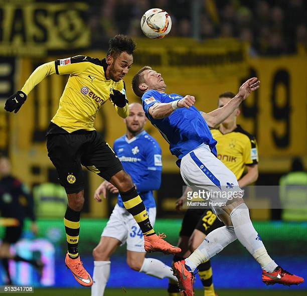PierreEmerick Aubameyang of Dortmund jumps for a header with Slobodan Rajkovic of Darmstadt during the Bundesliga match between SV Darmstadt 98 and...