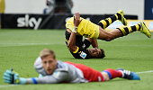 PierreEmerick Aubameyang of Dortmund looks for the ball after he missed to score against goalkeeper Oliver Baumann of Hoffenheim during the...