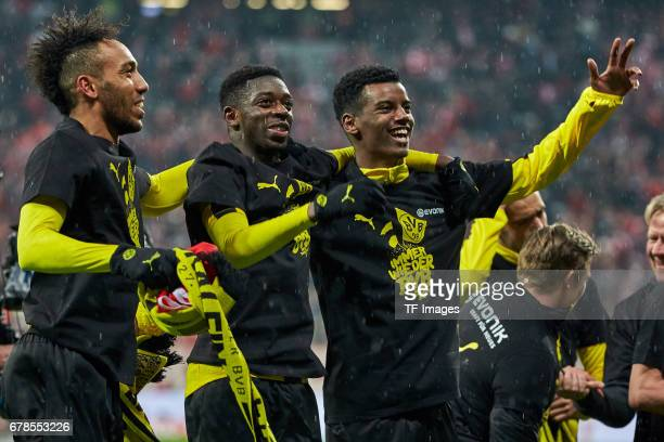 PierreEmerick Aubameyang of Dortmund Ousmane Dembele of Dortmund and Alexander Isak of Dortmund celebrates the win after the final whistle during the...
