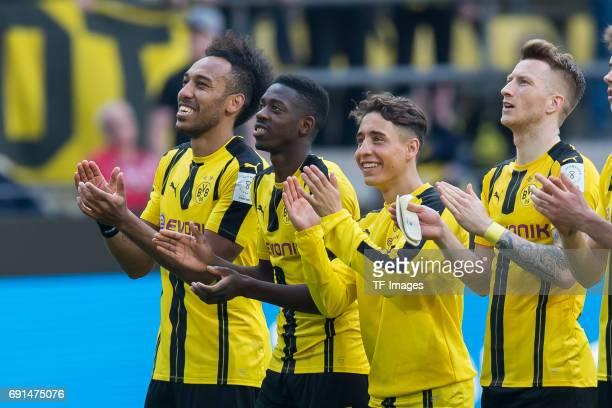 PierreEmerick Aubameyang of Dortmund Ousmane Dembele of Dortmund Emre Mor of Dortmund and Marco Reus of Dortmund looks on during the Bundesliga match...