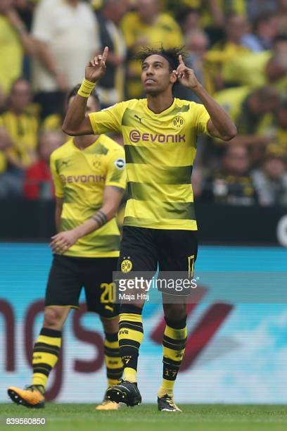 PierreEmerick Aubameyang of Dortmund points to the sky in celebration after he scored to make it 10 during the Bundesliga match between Borussia...