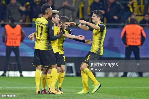 PierreEmerick Aubameyang of Dortmund Raphael Guerreiro of Dortmund Christian Pulisic of Dortmund and Marc Bartra of Dortmund celebrate their team`s...