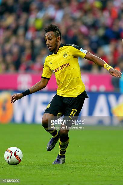 PierreEmerick Aubameyang of Dortmund runs with the ball during the Bundesliga match between FC Bayern Muenchen and BVB Borussia Dortmund at Allianz...