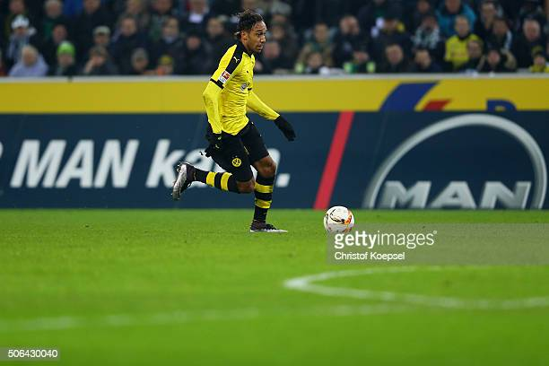 PierreEmerick Aubameyang of Dortmund runs with the ball during the Bundesliga match between Borussia Moenchengladbach and Borussia Dortmund at...