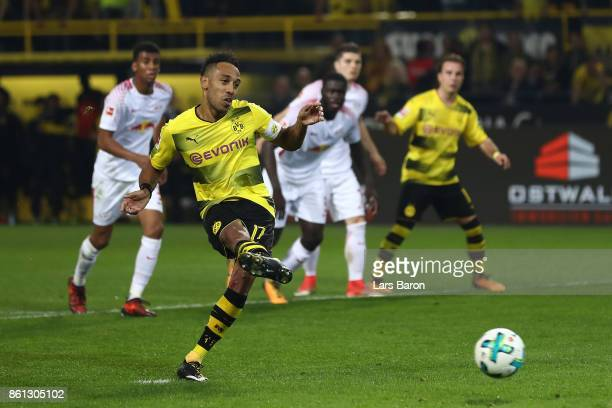 PierreEmerick Aubameyang of Dortmund scores a penalty goal to make it 23 during the Bundesliga match between Borussia Dortmund and RB Leipzig at...