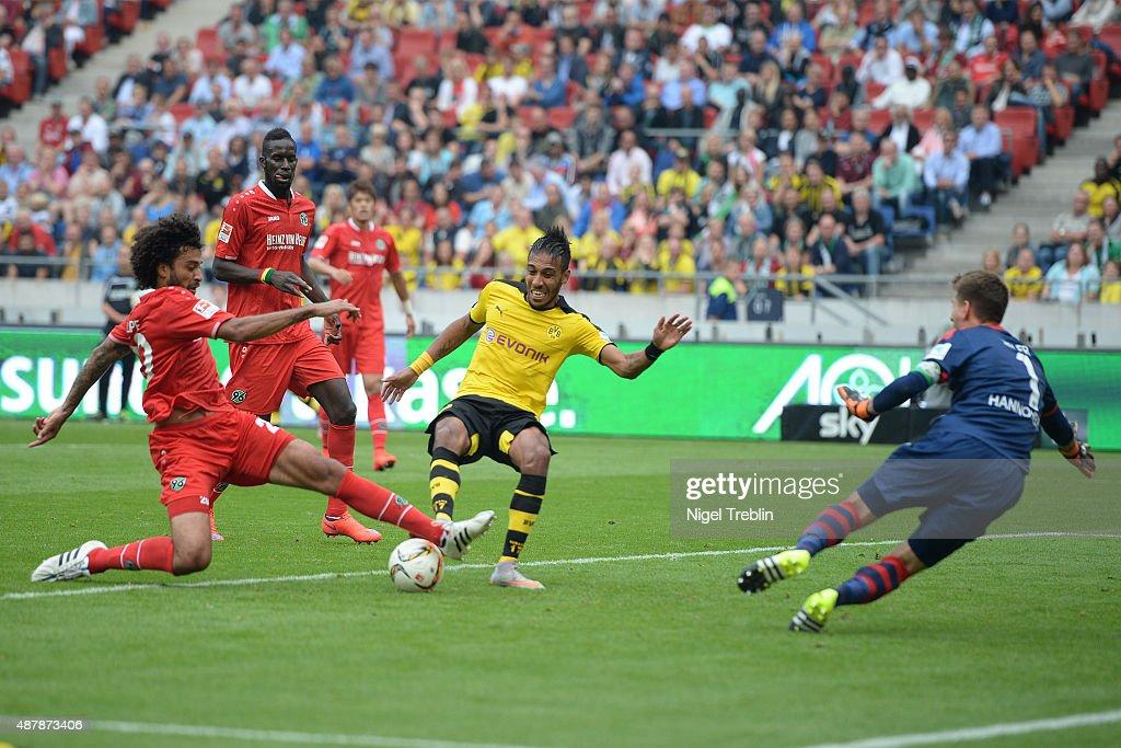 PierreEmerick Aubameyang of Dortmund scores his goal during the Bundesliga match between Hannover 96 and Borussia Dortmund at HDIArena on September...
