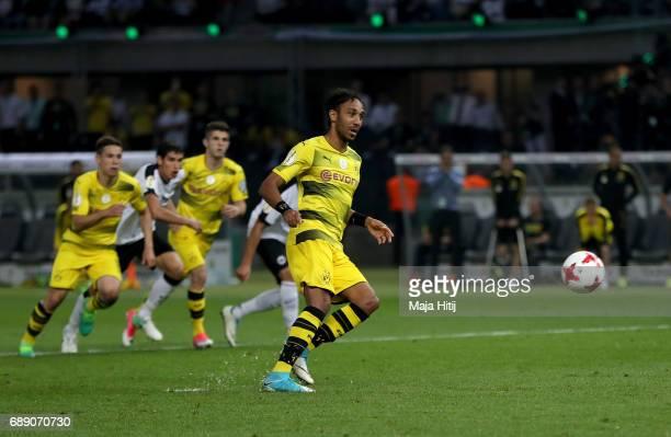PierreEmerick Aubameyang of Dortmund scores his team's second goal from the penalty spot during the DFB Cup final match between Eintracht Frankfurt...