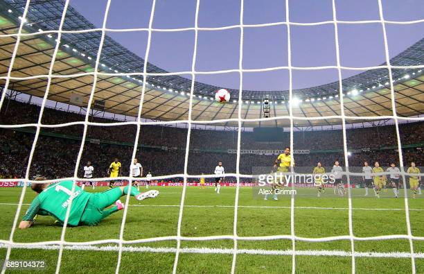 PierreEmerick Aubameyang of Dortmund scores his team's second goal from the penalty spot during the DFB Cup final match between Eintracht Frankfurt...