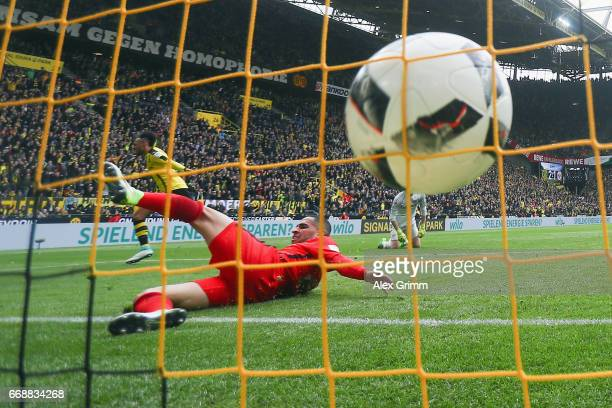 PierreEmerick Aubameyang of Dortmund scores his team's third goal past Omar Mascarell of Frankfurt during the Bundesliga match between Borussia...
