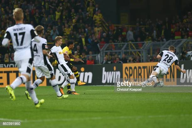 PierreEmerick Aubameyang of Dortmund scores his teams third goal to make it 30 during the Bundesliga match between Borussia Dortmund and Borussia...