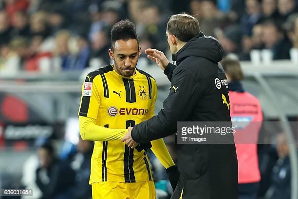 PierreEmerick Aubameyang of Dortmund shakes hands with Coach Thomas Tuchel of Dortmund during the Bundesliga match between TSG 1899 Hoffenheim and...