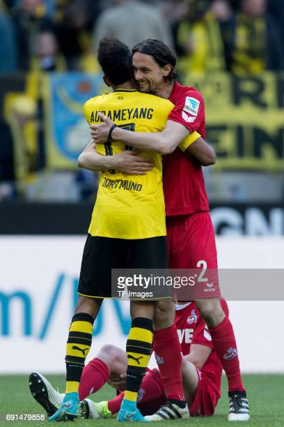 PierreEmerick Aubameyang of Dortmund shakes hands with Neven Subotic of Colonge during the Bundesliga match between Borussia Dortmund and FC Koeln at...