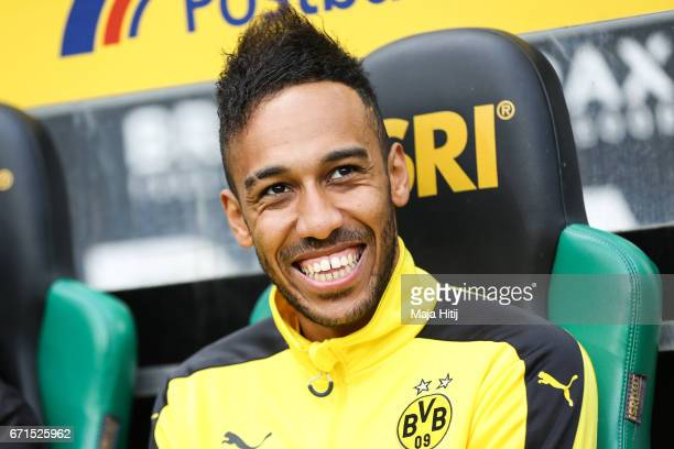 PierreEmerick Aubameyang of Dortmund sits on the bench prior the Bundesliga match between Borussia Moenchengladbach and Borussia Dortmund at...