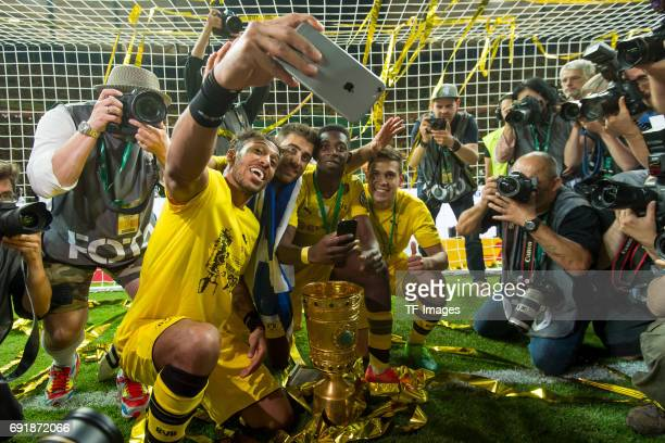 PierreEmerick Aubameyang of Dortmund takes a selfie with Sokratis of Dortmund Ousmane Dembele of Dortmund and Raphael Guerreiro of Dortmund after...