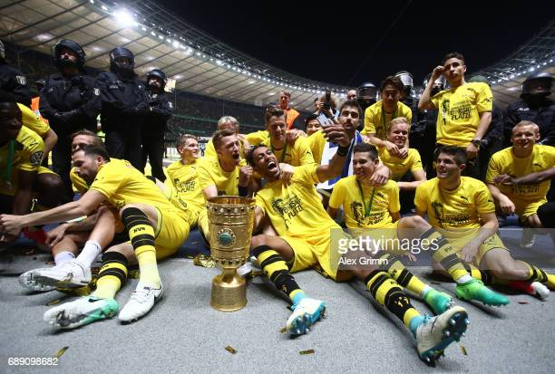 PierreEmerick Aubameyang of Dortmund takes a selfie with team mates while celebrating with the trophy after winning the DFB Cup final match between...