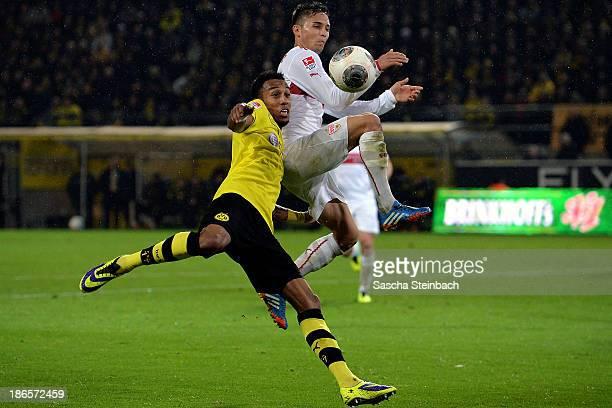 PierreEmerick Aubameyang of Dortmund vies with Moritz Leitner of Stuttgart as he scores his team's 6th goal during the Bundesliga match between...