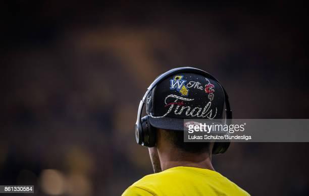 PierreEmerick Aubameyang of Dortmund wears a cap prior to the Bundesliga match between Borussia Dortmund and RB Leipzig at Signal Iduna Park on...