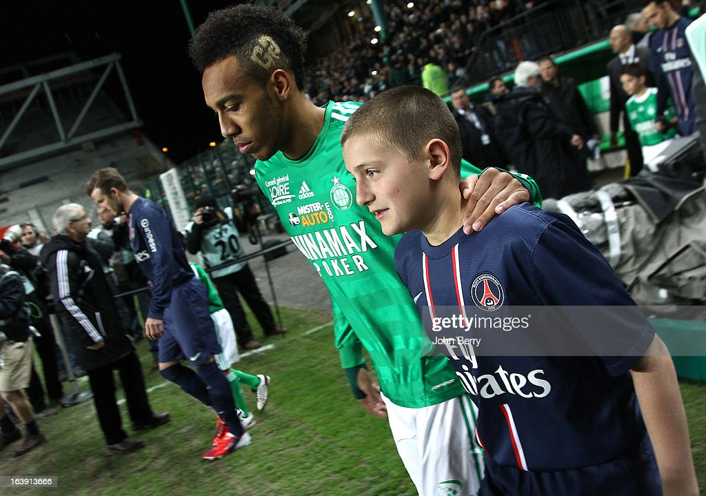 Pierre-Emerick Aubameyang of Saint-Etienne enters the field prior to the Ligue 1 match between AS Saint-Etienne ASSE and Paris Saint-Germain FC at the Stade Geoffroy-Guichard on March 17, 2013 in Saint-Etienne, France.