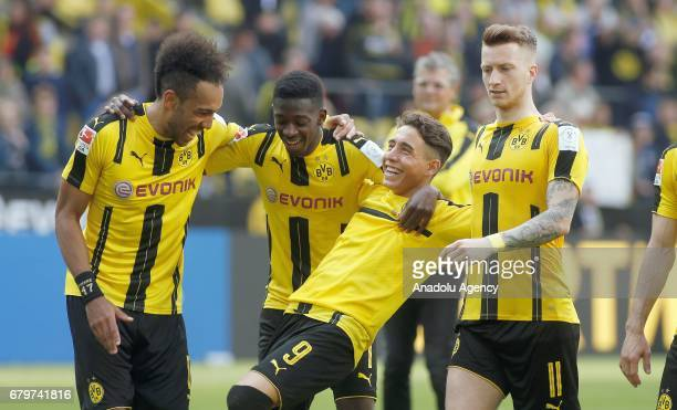 DORTMUND GERMANY MAY 6 PierreEmerick Aubameyang Ousmane Dembele Emre Mor and Marco Reus celebrate the 21 victory against Hoffenheim after the...