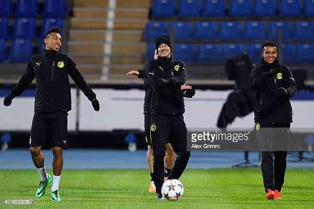 PierreEmerick Aubameyang Robert Lewandowski and Marian Sarr of Dortmund exercise during a training session ahead of the UEFA Champions League Round...