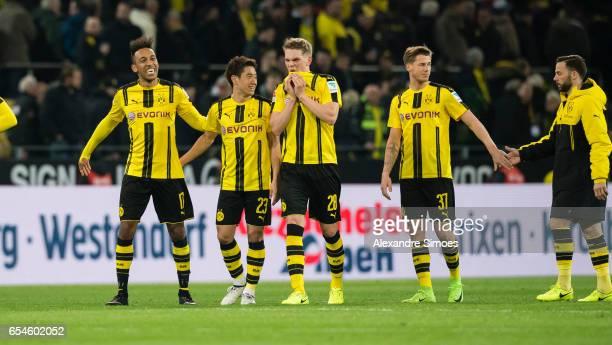 PierreEmerick Aubameyang Shinji Kagawa Matthias Ginter Erik Durm and Gonzalo Castro of Borussia Dortmund celebrate the win after the final whistle...