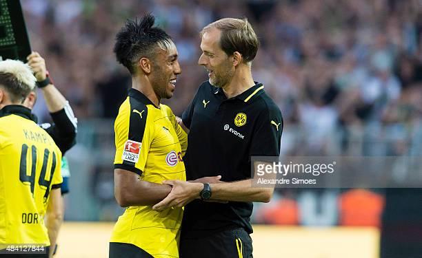 PierreEmerick Aubameyang with Manager Thomas Tuchel of Borussia Dortmund during the Bundesliga match between Borussia Dortmund v Borussia...