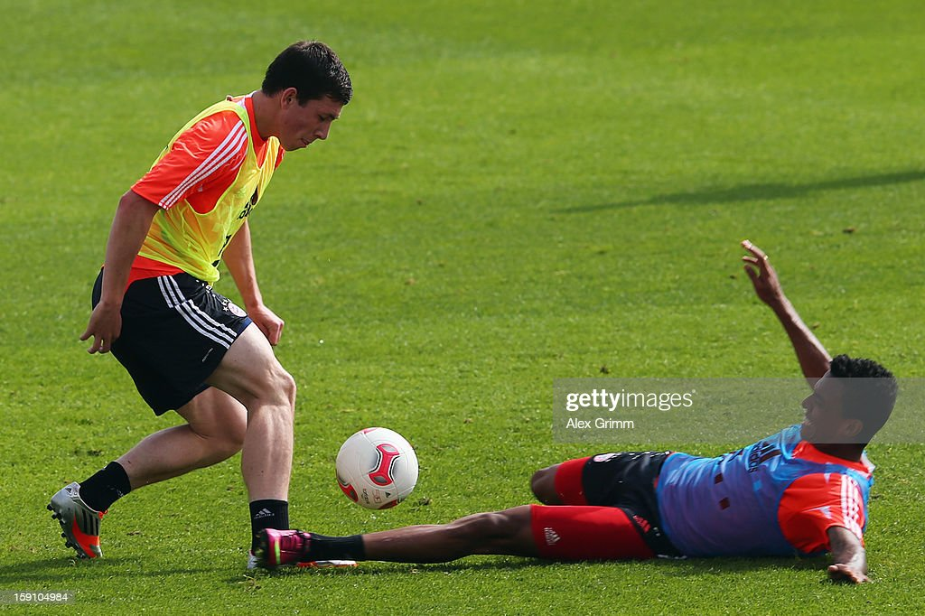 Pierre-Emile Hojbjerg (L) is challenged by Luiz Gustavo during a Bayern Muenchen training session at the ASPIRE Academy for Sports Excellence on January 8, 2013 in Doha, Qatar.