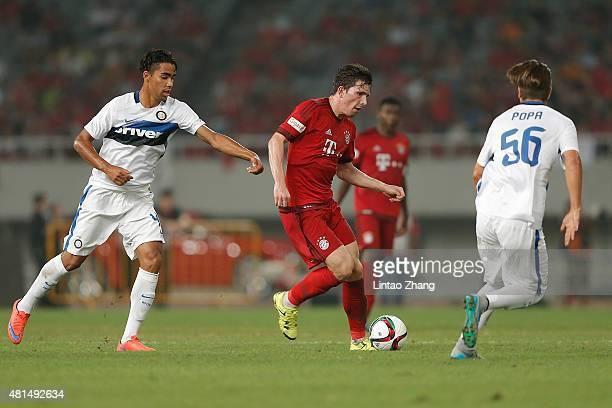 PierreEmile Hojbjerg of FC Bayern Muenchen challenges Popa Razvan of FC Internazionale during the international friendly match between FC Bayern...