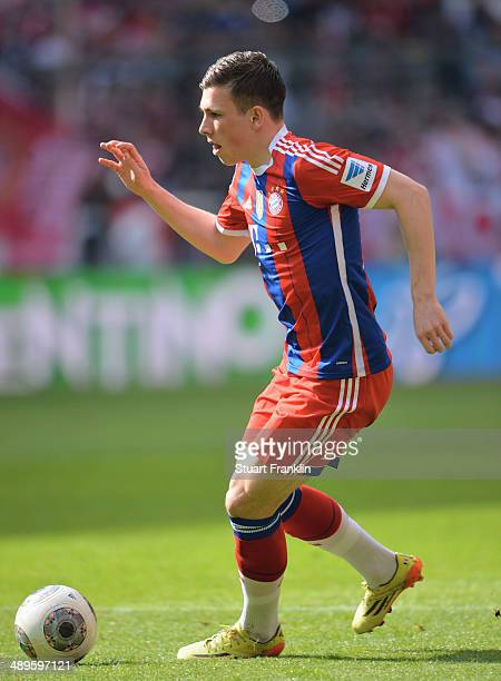 PierreEmile Hojbjerg of Muenchen in action during the Bundesliga match between Bayern Muenchen and VfB Stuttgart at Allianz Arena on May 10 2014 in...