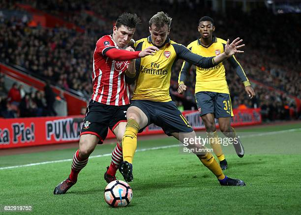 PierreEmile Hojbjerg of Southampton and Rob Holding of Arsenal in action during the Emirates FA Cup Fourth Round match between Southampton and...